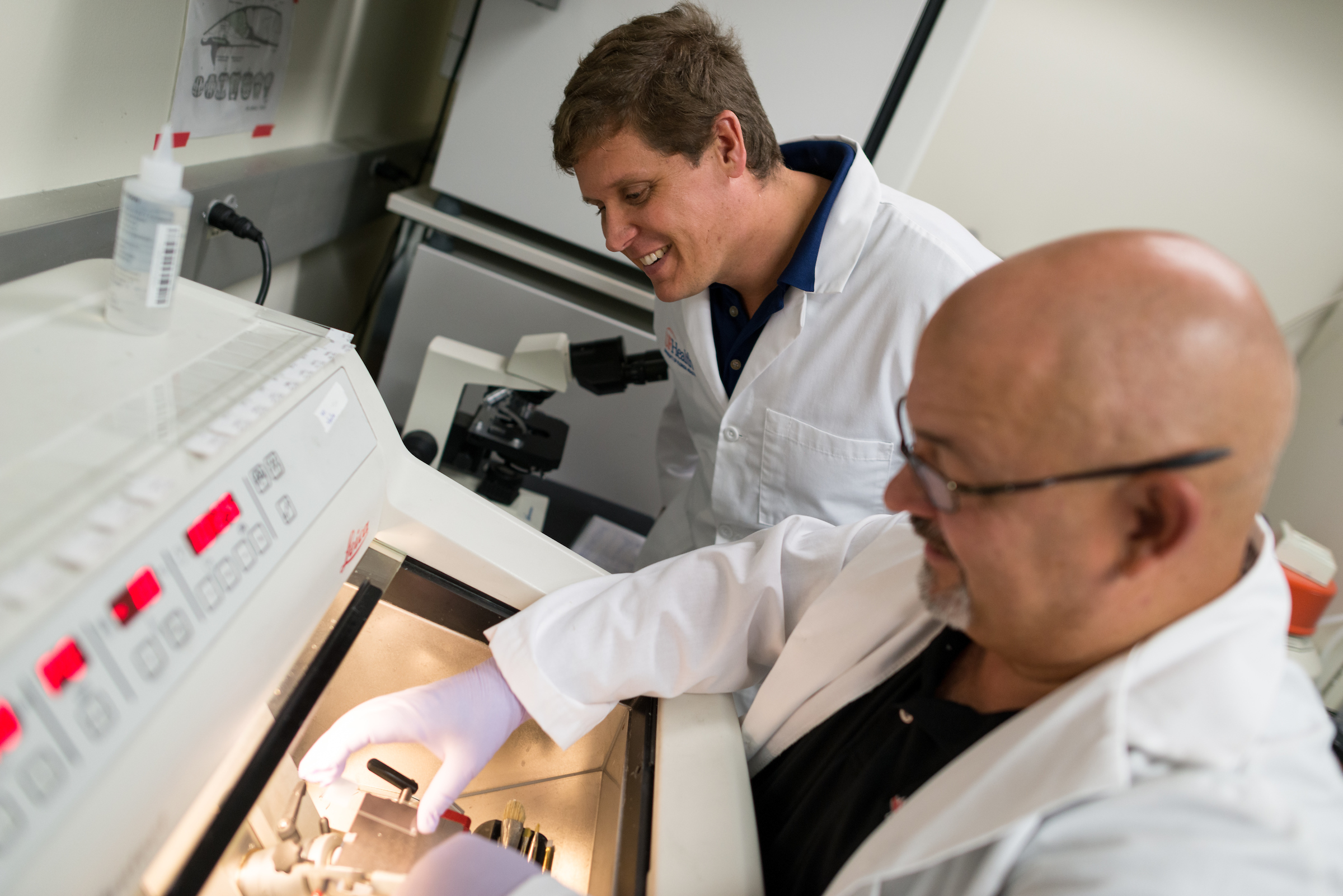 Jeremy McIntyre conducting research with colleagues in the lab