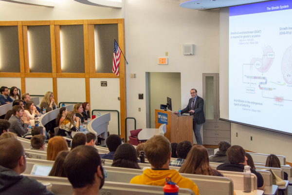 Dr. Lorenzo Leggio presents to a full house during his keynote speech.