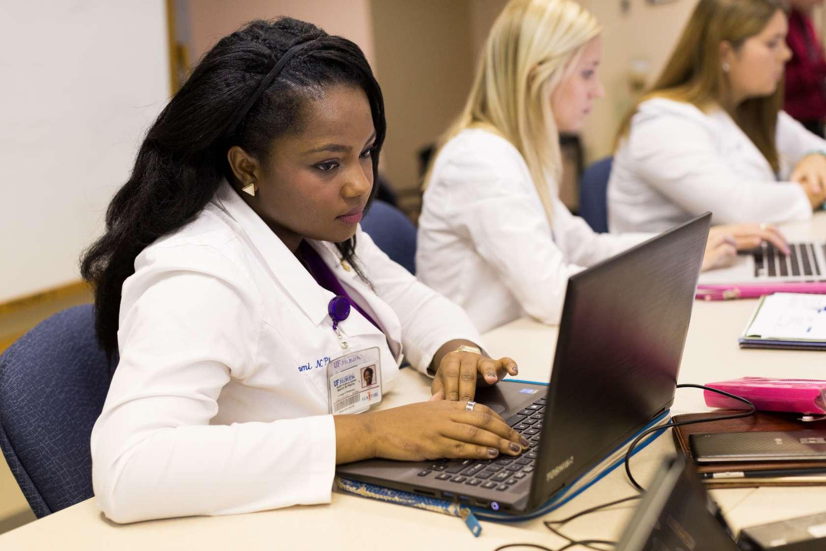 young black woman at a computer