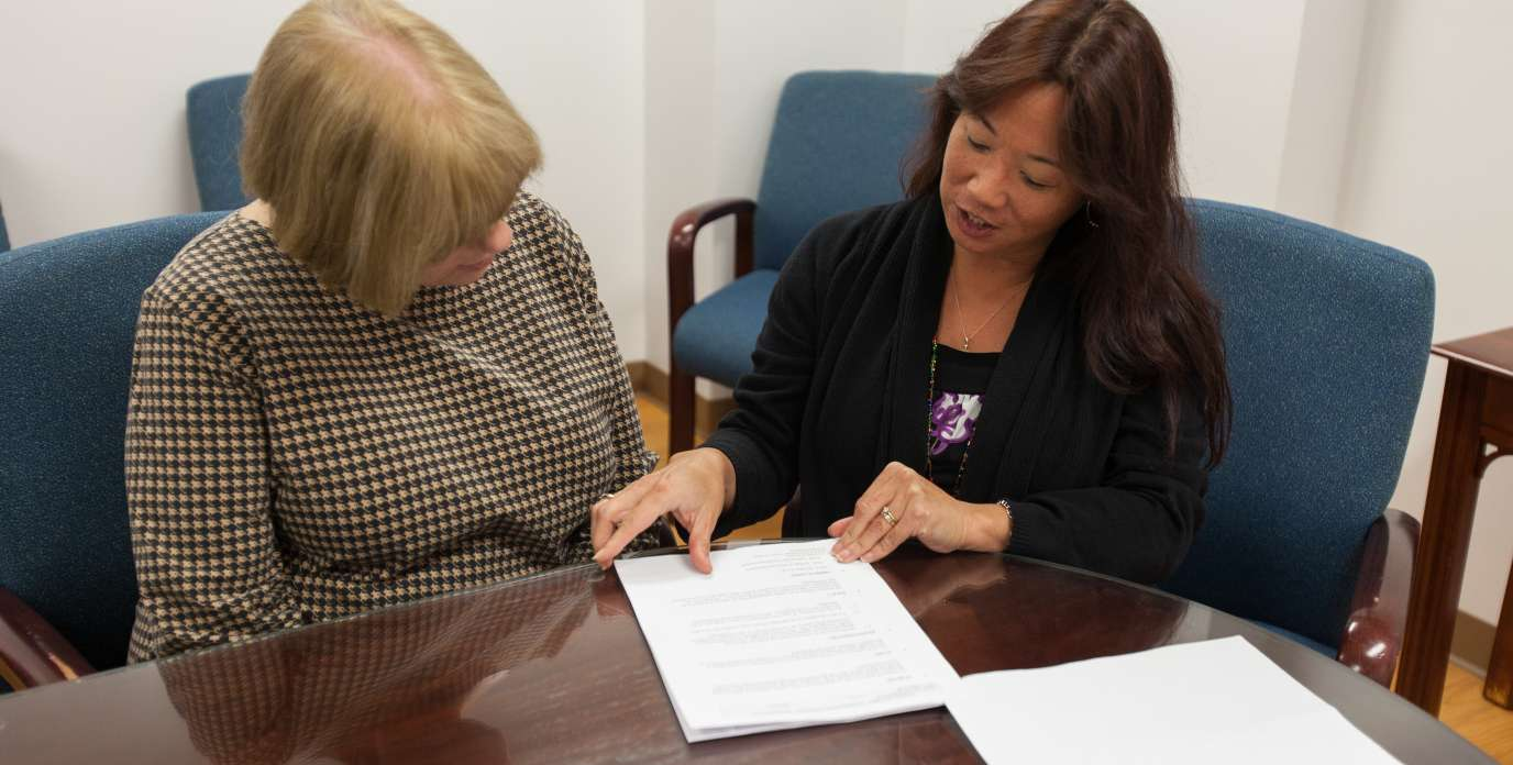 admin showing forms to a faculty member